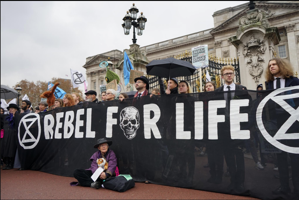 Mary Ann with Rebel For Life banner